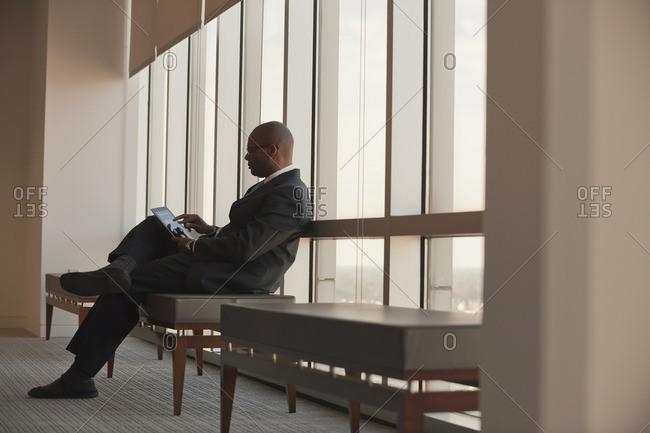 African American businessman using digital tablet