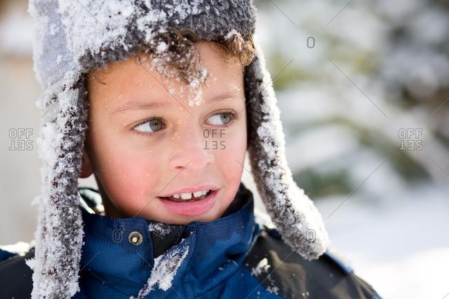 Boy looking away in snowy setting