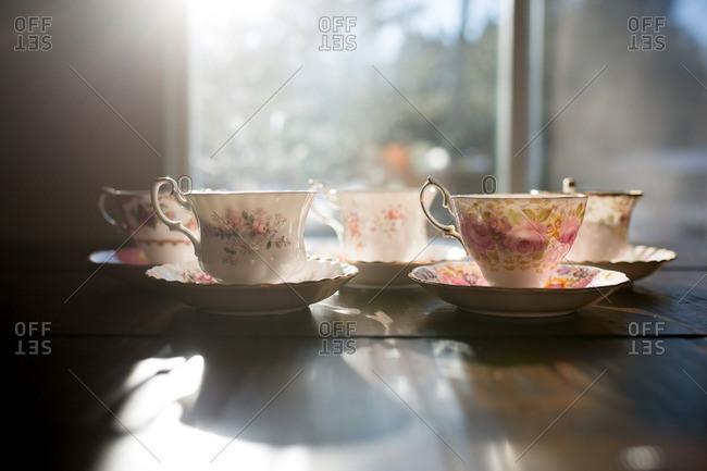 Teacups on table in sunlight