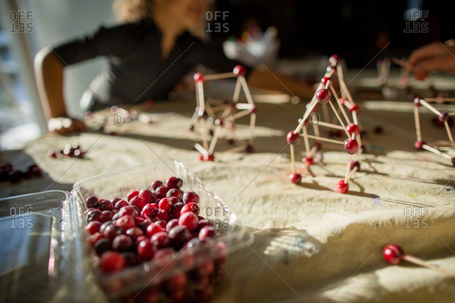 Girl making cranberry toothpicks craft