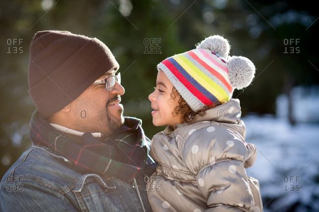 Man holding girl in winter setting