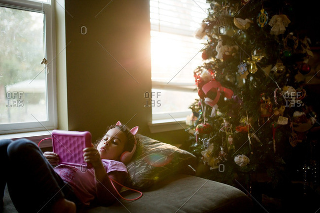 Girl watching tablet at Christmastime