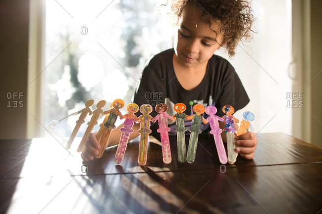 Girl making popsicle stick art