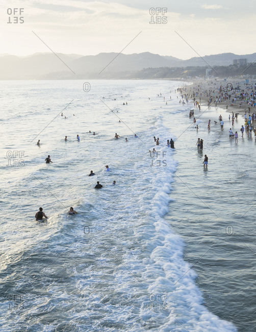 Santa Monica, Los Angeles County, California, USA - April 27, 2008: Large group of people swimming in the ocean at Santa Monica, California.