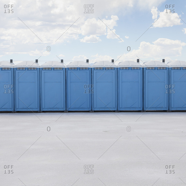 Row of portable toilets on salt flats, during Speed Week