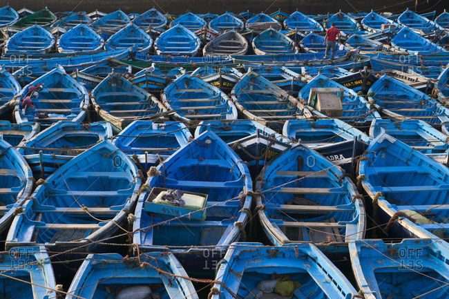 Essaouira, Morocco - October 12, 2003: Boats moored very close together in the harbor of Essaouira, Morocco