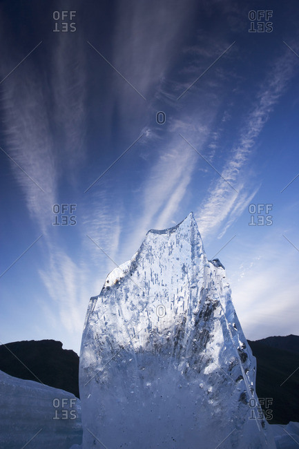 A shard of aufeis reaches toward the arctic sky.
