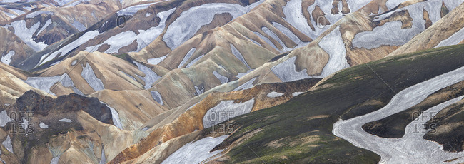 An aerial view of the Landmannalaugar Mountains in Iceland. Rhyolite mountains and expansive lava fields.