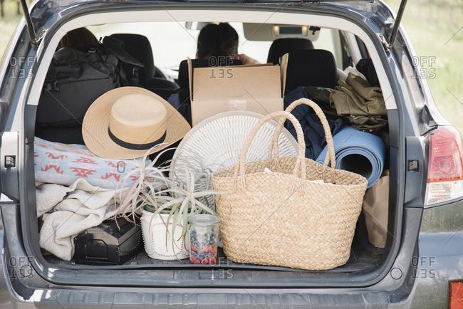 An estate car trunk full of bags and belongings.