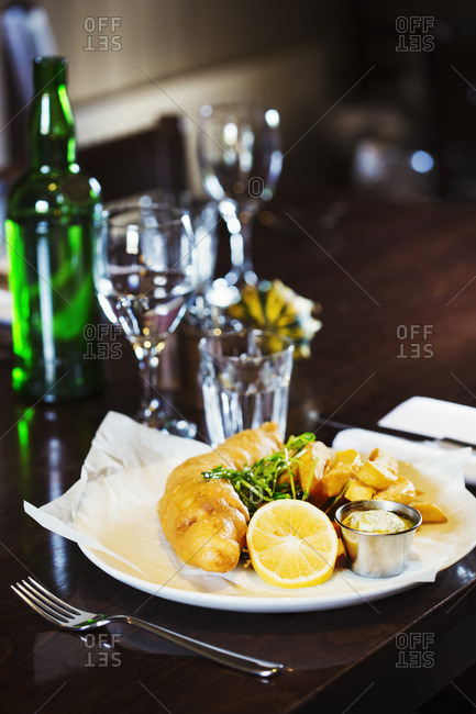 Village public house food. A cooked main course, dish on a dining table, fish and chips