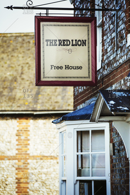 England - November 3, 2016: The Red Lion village public house pub sign outside the local pub.