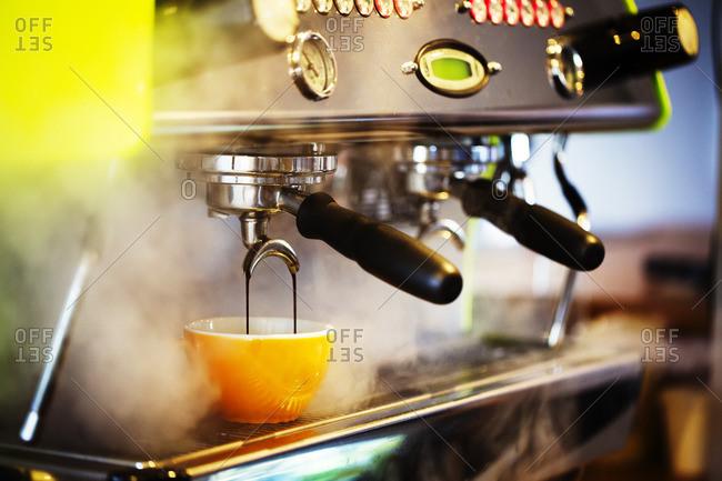 Close up of an espresso machine in a restaurant.