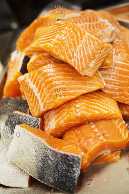 Close up of a stack of salmon fillets.