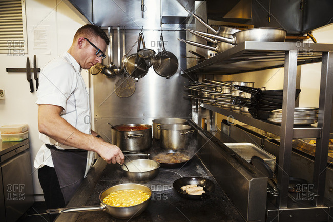 Chef cooking in a restaurant kitchen.