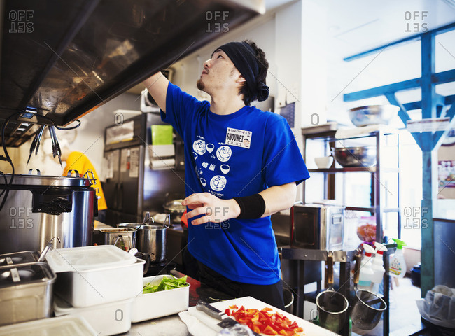 Japan - July 25, 2015: Ramen noodle shop. Staff in a small kitchen preparing food