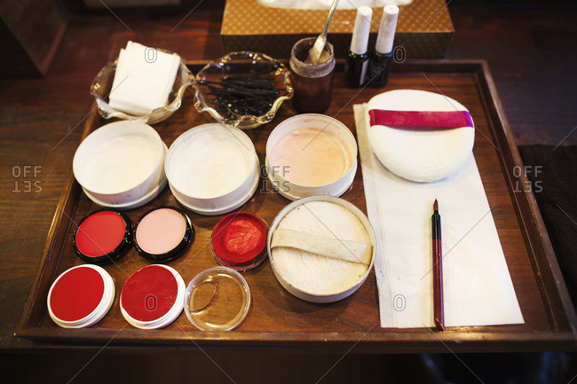 A tray of pots, rice powders, blushers and loose powder used in the white face make up of geisha women