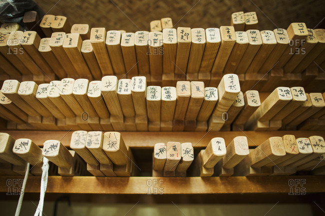 Shelves of wooden moulds for specialist treats, sweets called wagashi.