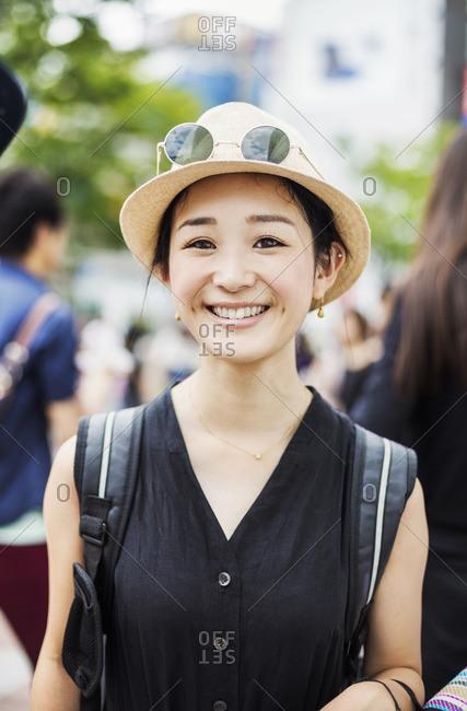 Portrait of a smiling young woman wearing a hat.