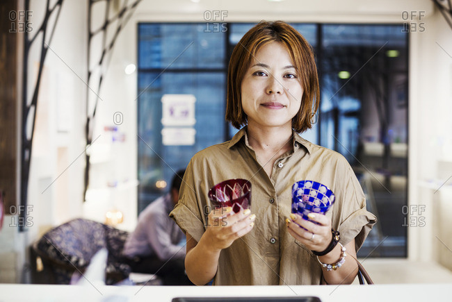 Saleswoman in a shop selling Edo Kiriko cut glass in Tokyo, Japan.