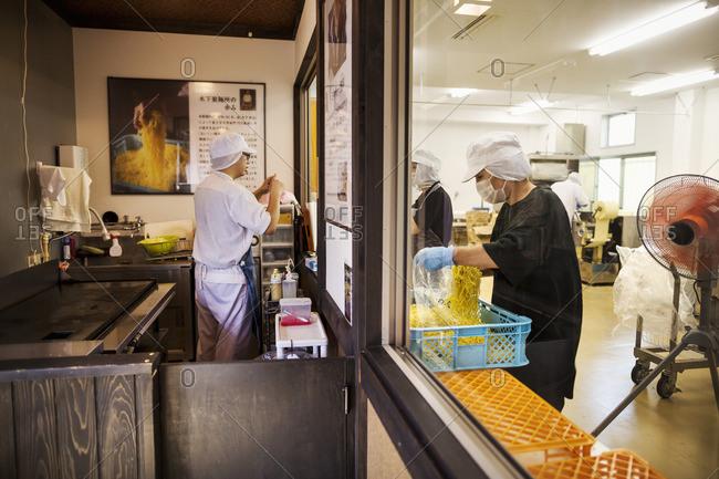 Japan - August 4, 2016: View of the noodle factory production unit from a commercial  kitchen serving a noodle shop