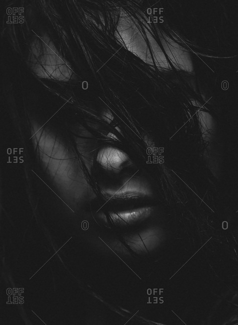 Portrait of a model with hair covering her face