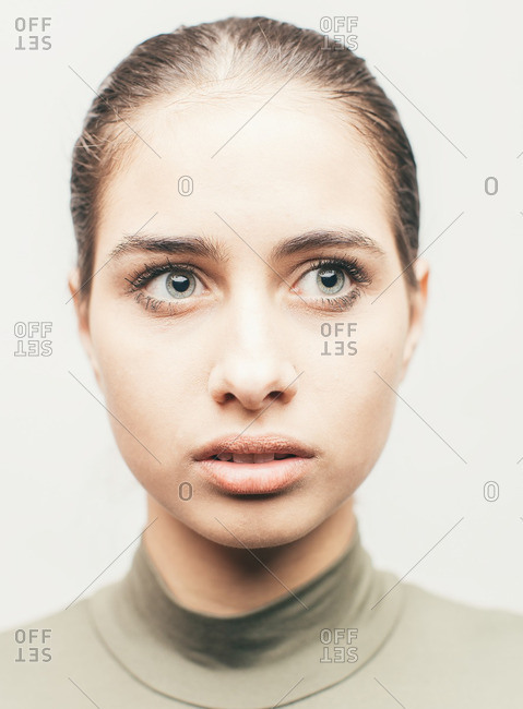 Portrait of a young Latina model with hazel eyes looking away