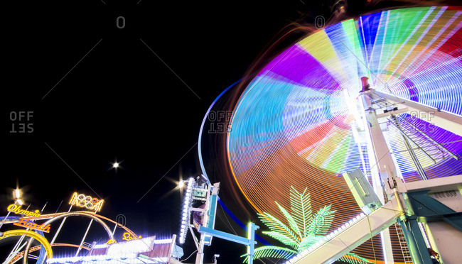 Munich - December 12, 2016: Long time exposure at night at the Oktoberfest, fairground rides