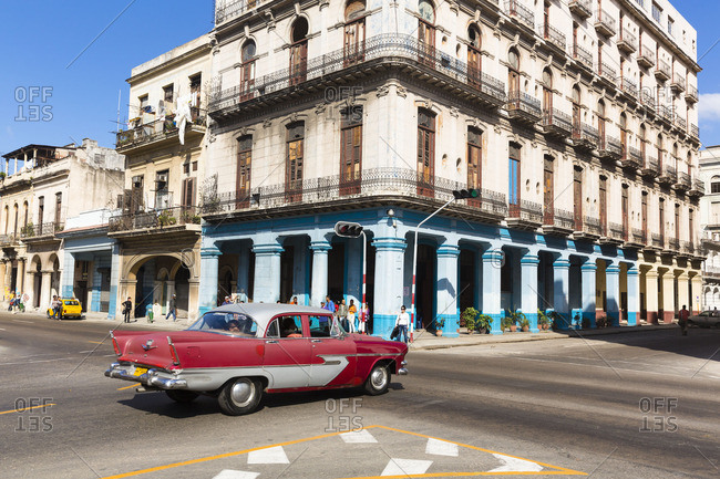 Havana - March 4, 2016: Vintage car on a junction in front of a colonial building, Havana, La Habana, Cuba, the republic Cuba, the Greater Antilles, the Caribbean