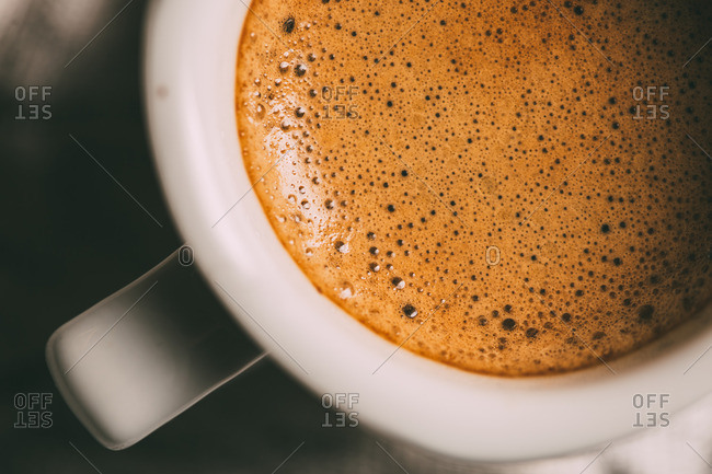 Coffee cup on white cloth