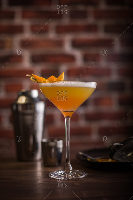 Classic cocktail on old bricks background