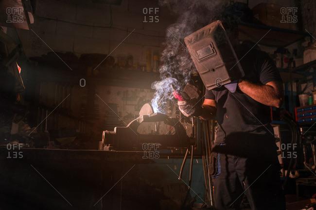 worker using an oxyacetylene welder