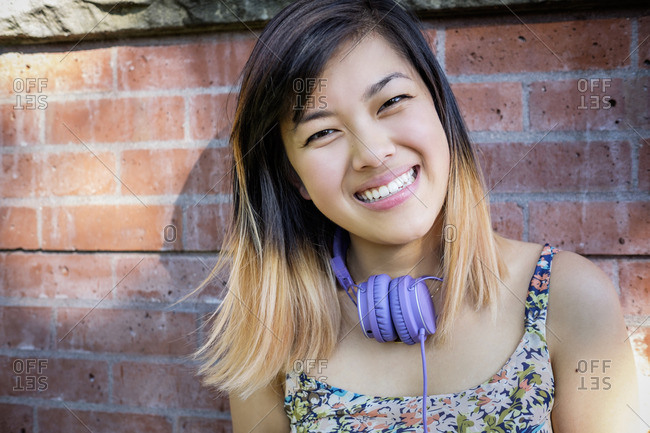 Portrait of smiling Chinese woman with headphones