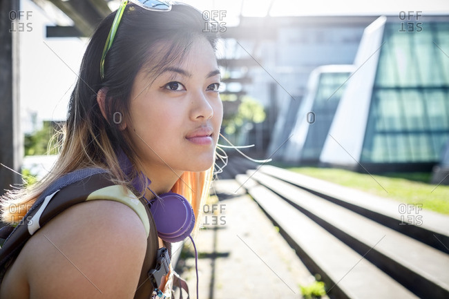 Portrait of pensive Chinese woman with headphones