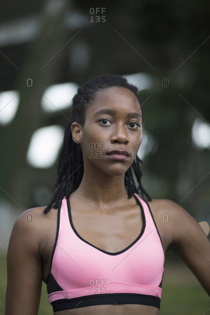 Serious Mixed Race woman wearing pink sports-bra