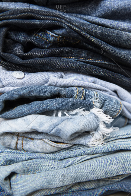 Stack of folded blue jeans