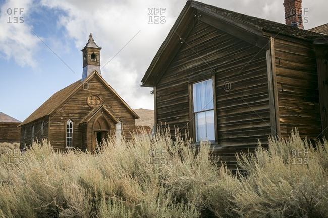 Rustic wooden buildings in tall grass