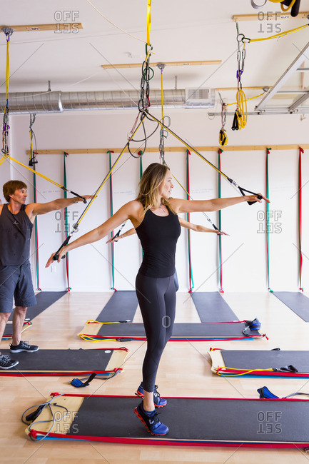 People using resistance bands in gymnasium