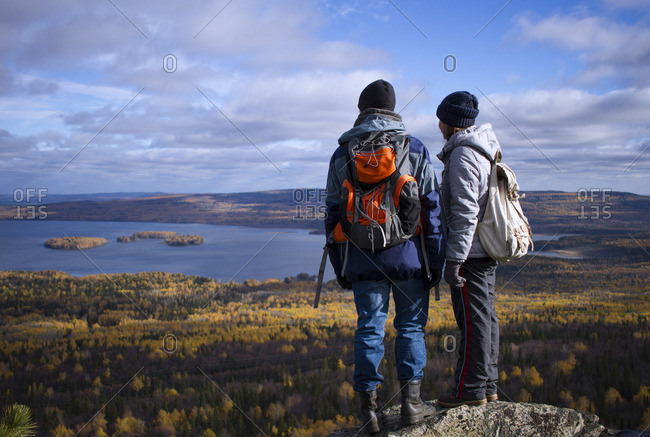 Caucasian couple backpacking in autumn landscape