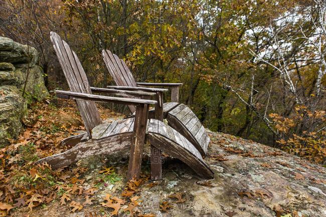 Autumn leaves near adirondack chairs
