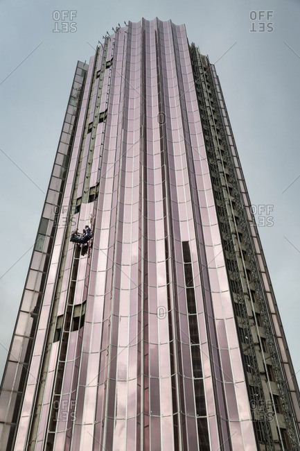 Window washers on tall building