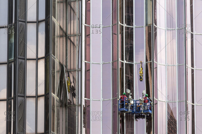 Men washing windows on skyscraper