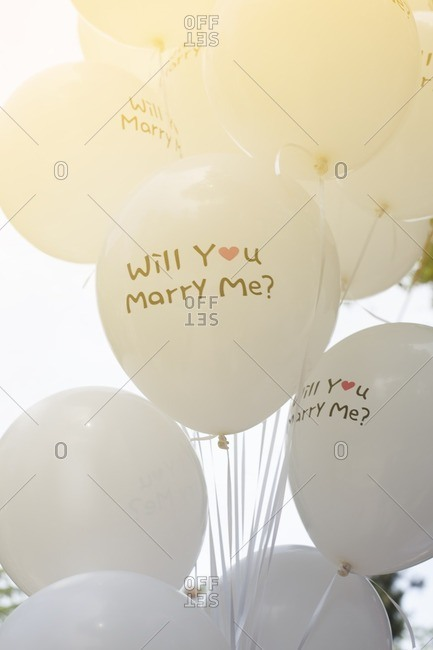 "Proposal balloons in the sky with message says ""will you marry me?"""