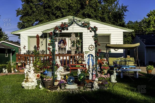 Yankton, South Dakota, USA - July 8, 2016: Display of statuary in front yard of house
