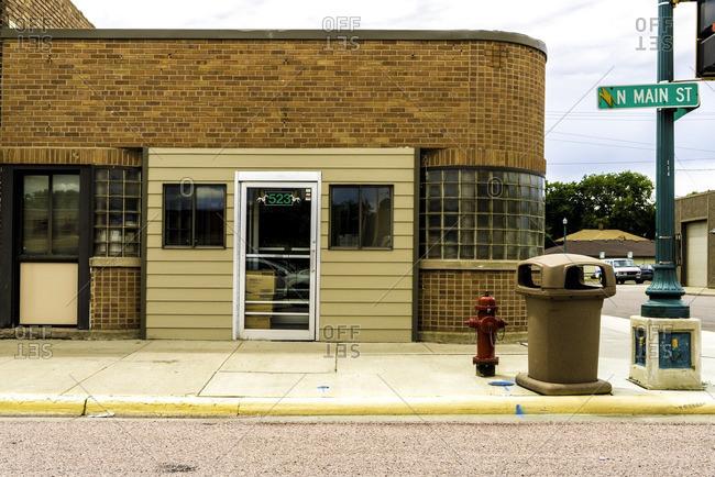 Mitchell, South Dakota, USA - July 8, 2016: Brick building on the corner of Main Street