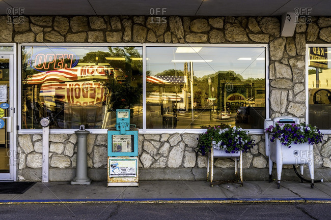 Yankton, South Dakota, USA - July 8, 2016: Exterior of Laundromat with American flag reflected in window