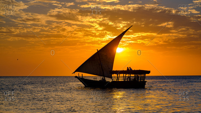 Tanzania, Africa - November 9, 2016: Boat sailing at sunset off the coast of Tanzania, Africa