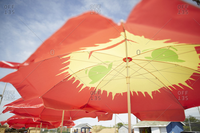 Bright, colorful umbrella on a beach