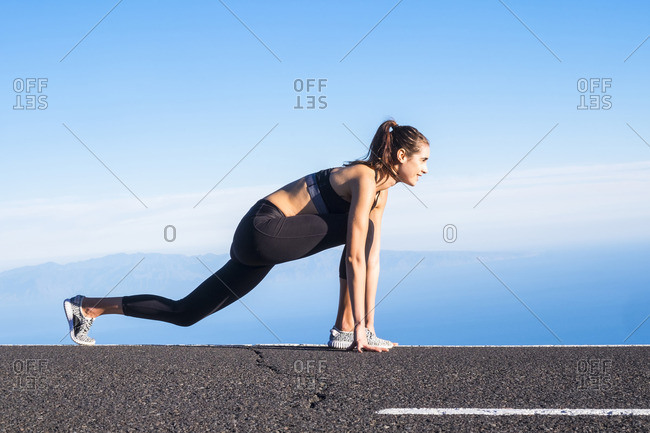 Young woman training on empty street