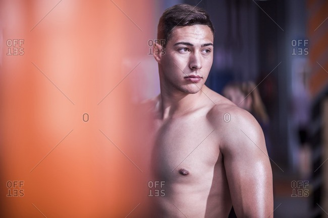 Bare-chested young man in gym