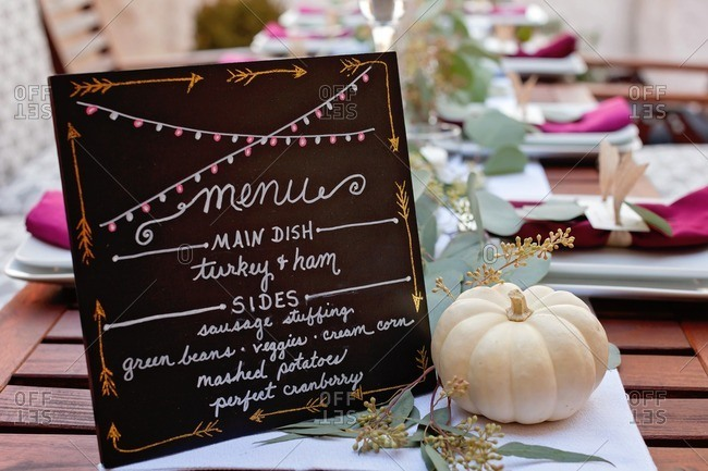 Menu at an outdoor Thanksgiving dinner party